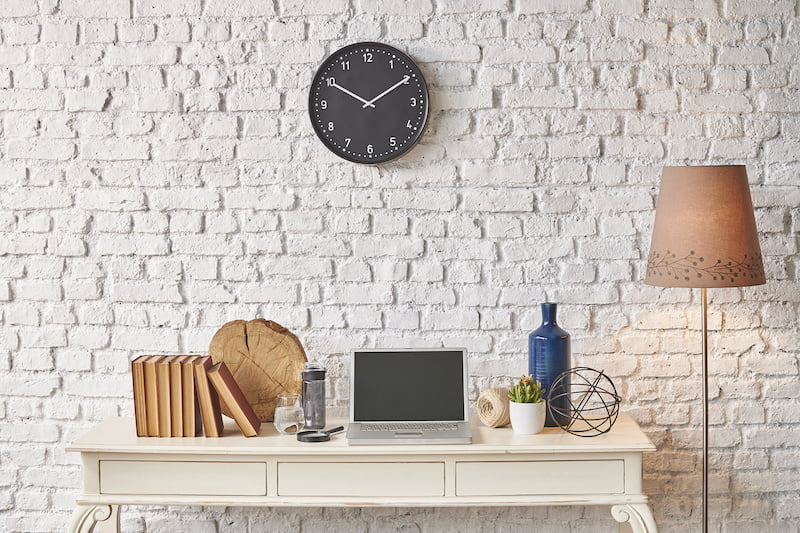 brick wall banner, laptop, black clock, winter style