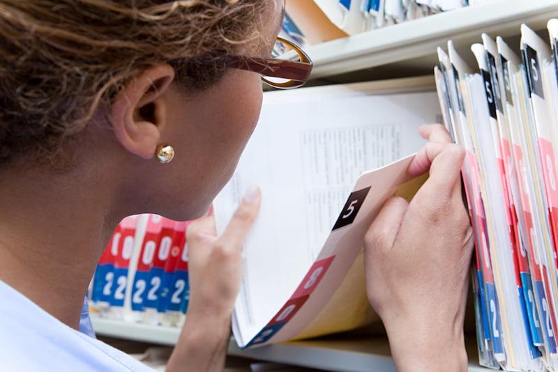 Administrator looking at medical record