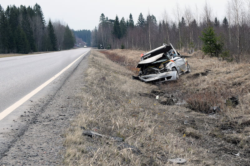 Car after bad accident. Total damaged car in roadside.