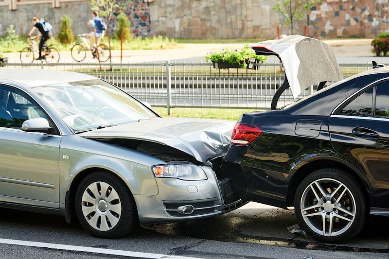 Car collision on city street. car crash accident. Two damaged automobiles